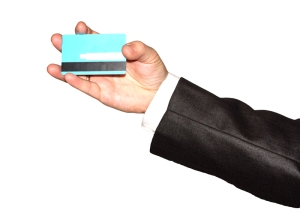 Businessman's hand holding blue credit cards 03. Isolated on whi