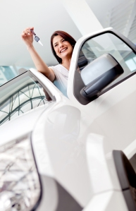 Happy woman buying a car