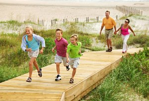 getty_rf_photo_of_family_on_boardwalk_at_beach