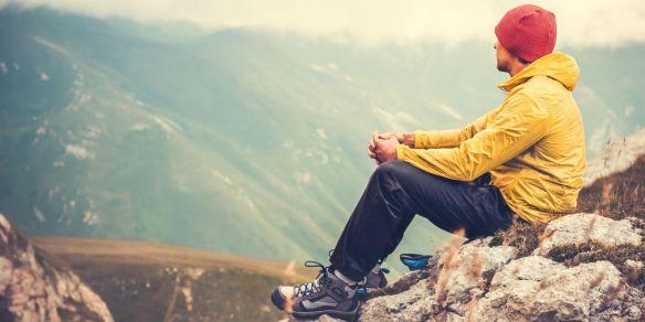 bigstock-Man-Traveler-relaxing-alone-in-84557870