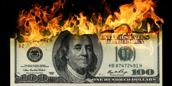 bigstock-Burning-dollars-close-up-over-24044192