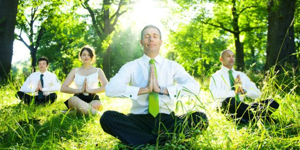 bigstock-Business-people-meditating-out-65025178