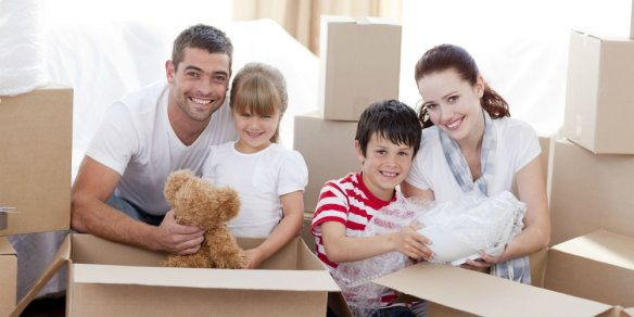 bigstock-Family-Moving-Home-With-Boxes-6143817
