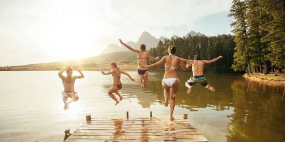 bigstock-Friends-Jumping-Into-The-Water-119847851