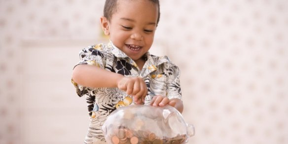 bigstock-Young-boy-putting-money-in-pig-73102693-e1458943484856-1