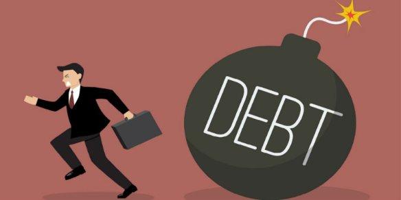 bigstock-Businessman-Run-Away-From-Debt-103353212