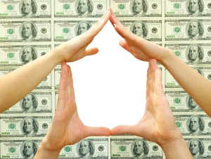 House made of woman hands isolated on dollars background