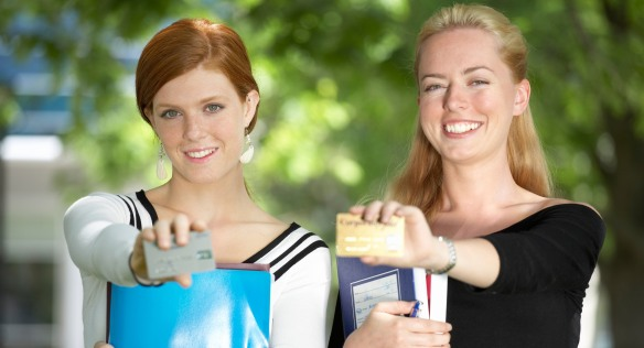 ahmxmt-woman-displaying-credit-cards-in-park-college-student-2