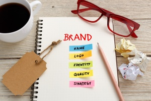 Brand marketing concept with notebook, brand tag and coffee cup on office desk