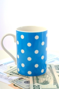 USA Tax Day, April 15, coffee break with tax return, cash and coffee mug, vertical.