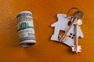house key and dollars.Real estate concept
