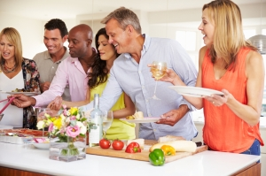 Group Of Mature Friends Enjoying Buffet At Dinner Party